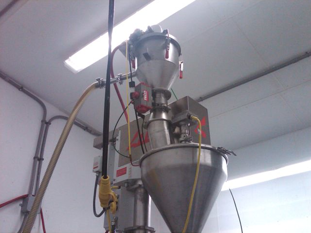 VAC-U-MAX custom pneumatic conveying system above filling machine at Nutriom plant.
